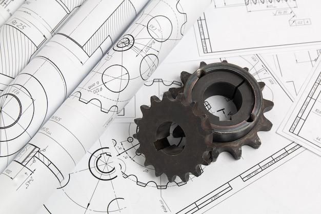 Aandrijfkettingwielen en technische tekeningen van industriële onderdelen en mechanismen