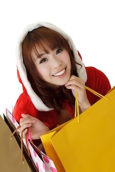 Aantrekkelijk kerstmismeisje die en bads winkelen houden.