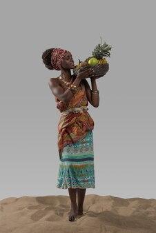 Aantrekkelijke jonge afrikaanse vrouwen dragende vruchten