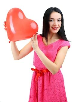 Aantrekkelijke jonge vrouw met ballon geïsoleerd op wit