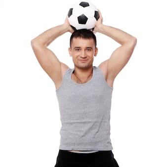 Aantrekkelijke man met voetbal