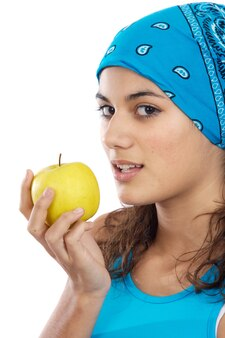 Aantrekkelijke meisjeswhit een appel a over witte achtergrond
