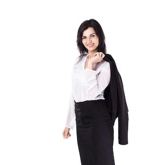 Aantrekkelijke, succesvolle zakenvrouw, zelfverzekerde blik in het frame met zijn jas op zijn rug
