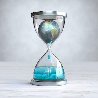 Aarde planeet in zandloper, opwarming van de aarde concept.