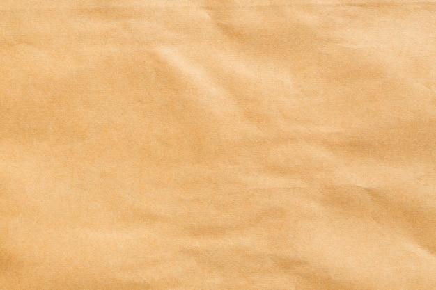 Abstract bruin kringloop verfrommeld document voor achtergrond, vouw van pakpapiertexturen voor ontwerp