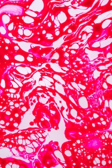 Abstract fuchsia spinneweb in olie
