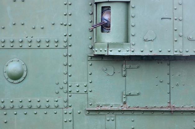 Abstract groen industrieel metaal geweven met klinknagels en bouten