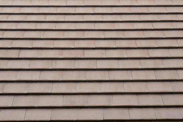 Abstract het dakpatroon van de achtergrondtextuur bruin tegel