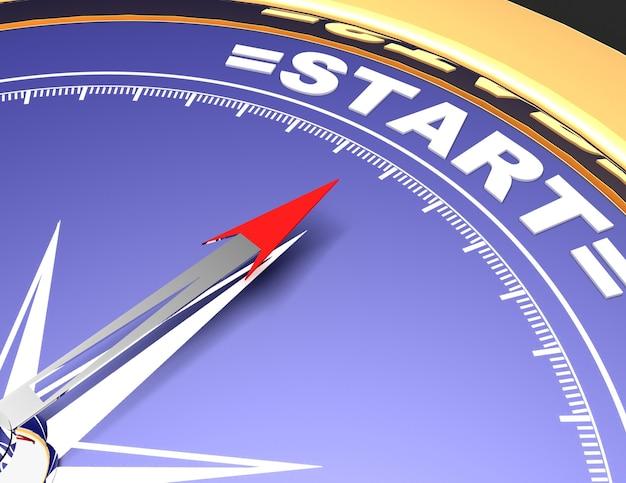 Abstract kompas met naald die het woord start.start-concept wijst