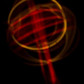 Abstract neonlichten gebogen ontwerp op donkere achtergrond