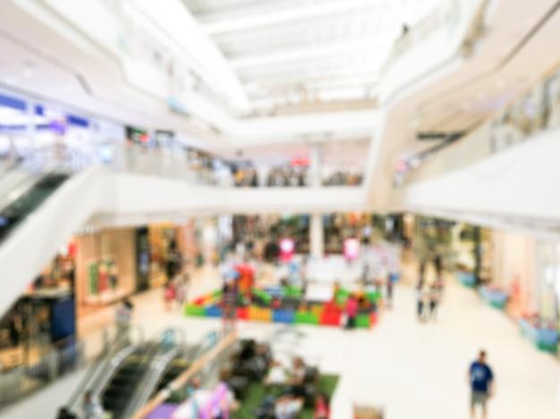 Abstract onduidelijk beeldwinkelcomplex van warenhuisbinnenland voor achtergrond. wazig beeld interieur van grote zaal winkelcentrum.