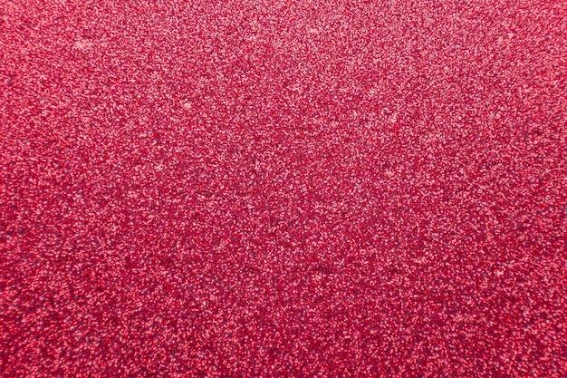 Abstract rood glitter achtergrond met ruwe textuur