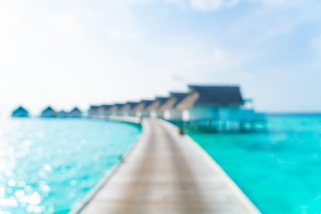 Abstract vervagen tropische strand en zee in de maldiven voor achtergrond