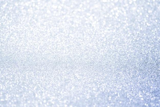 Abstract zilver glitter bokeh lichten met zachte lichte achtergrond.
