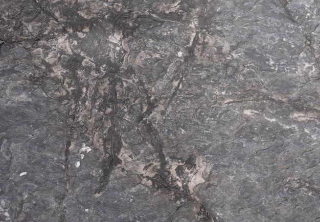 Abstracte achtergrond en texturen van donkergrijze steen