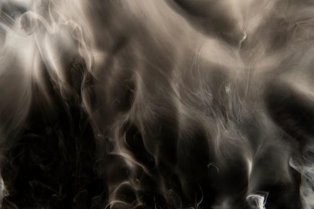 Abstracte achtergrond, gouden rooktextuur filmisch ontwerp