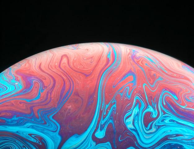 Abstracte achtergrond met heldere perzik en blauwe bol