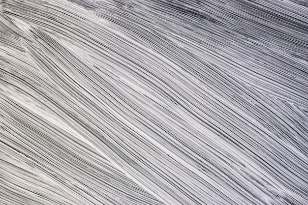 Abstracte achtergrond. penseelstreken op een chen-achtergrond. duidelijke grenzen. handwerk met een borstel.