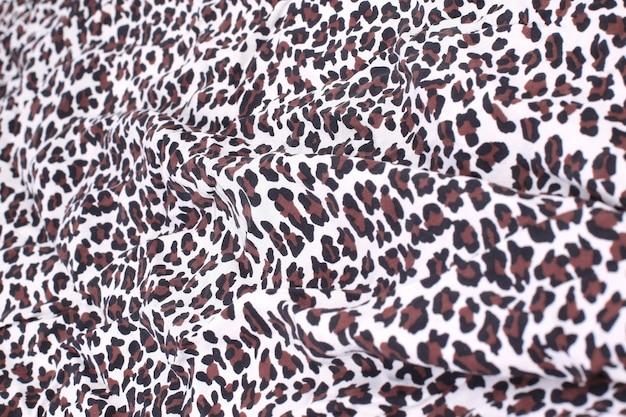 Abstracte achtergrond samengesteld uit luipaard print stof. het concept van creativiteit