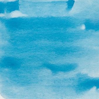 Abstracte achtergrond van blauwe waterverfverf