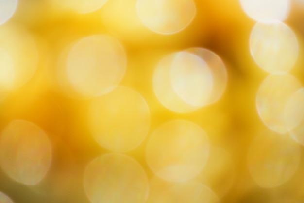 Abstracte achtergrond van de geel-gouden bokeh. intreepupil abstracte bokeh achtergrond