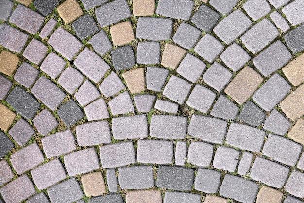 Abstracte achtergrond van de weg van stenen straatstenen bekleed met golven