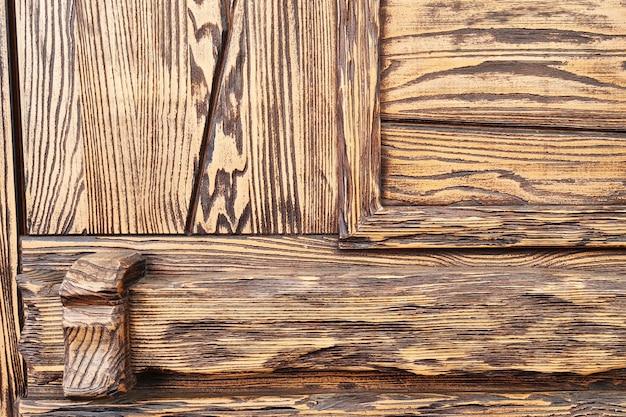 Abstracte achtergrond van geweven bruine houten deur. loft ontwerp van modern gebouw.