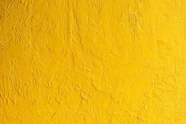Abstracte achtergrond van gouden muurtextuur met zonlicht. luxe en elegant behang.