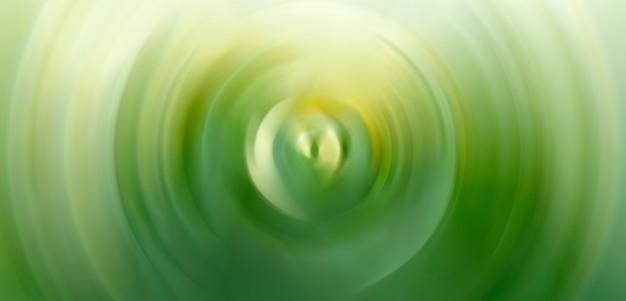 Abstracte achtergrond van groene spin cirkel radiale motion blur.