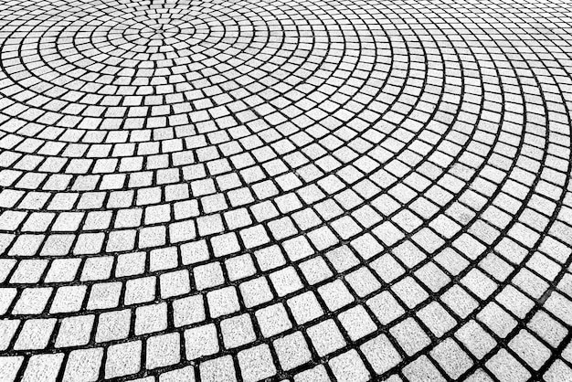 Abstracte achtergrond van metselwerkpatroon dat op vloer in krommevorm wordt verfraaid.