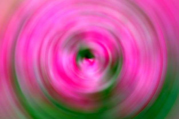 Abstracte achtergrond van roze radiale de motieonduidelijk beeld van de rotatiecirkel.