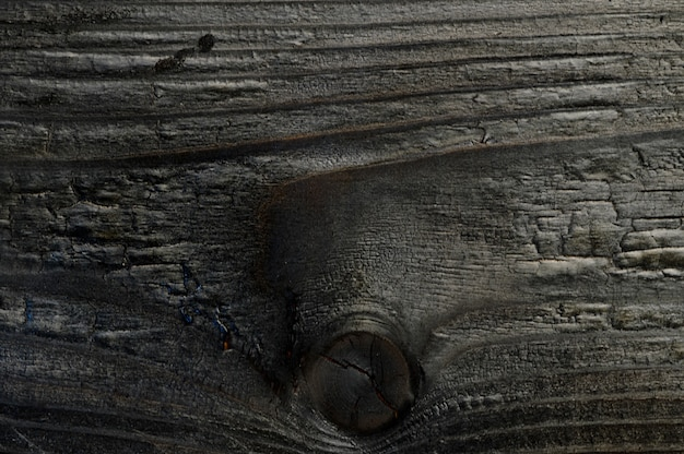 Abstracte achtergrond van verbrande houten plank close-up bovenaanzicht