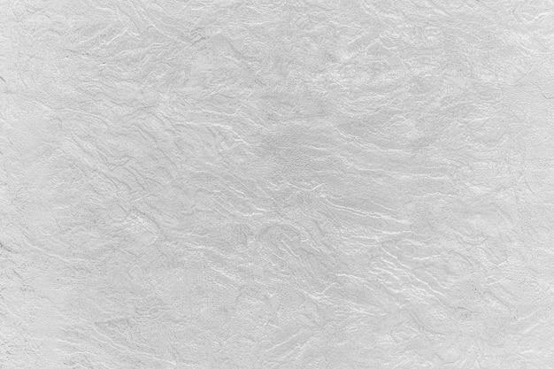 Abstracte achtergrond van witte betonnen structuur met krassen.