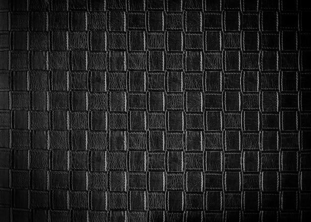 Abstracte achtergrond van zwart leerpatroon op bank. retro en vintage achtergrond.