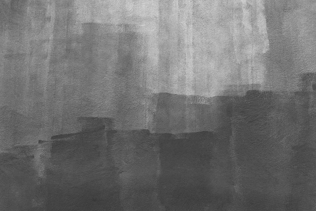 Abstracte achtergrond van zwarte kleur die op witte muur wordt geschilderd. kunst achtergrond.