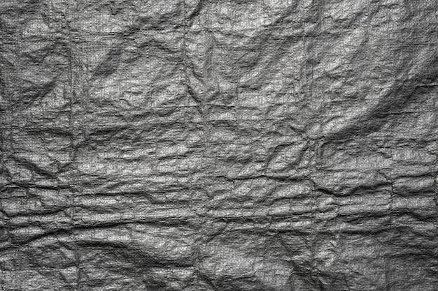 Abstracte achtergrond van zwarte plastic zaktextuur met grunge