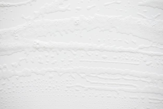 Abstracte achtergrond witte zeepachtige schuimtextuur