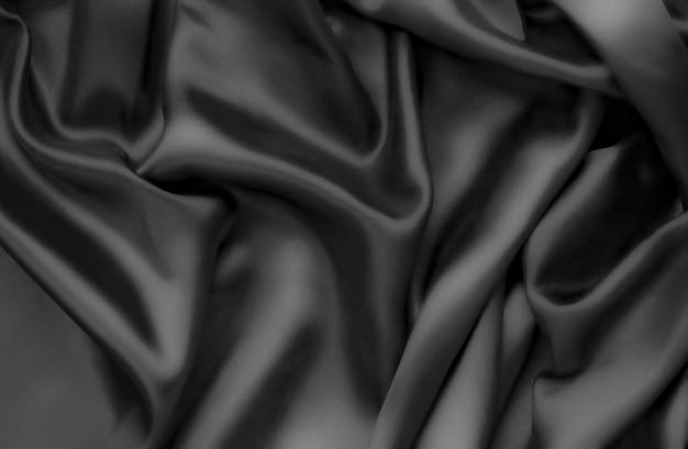Abstracte achtergrondluxedoek of vloeibare golf of golvende vouwen