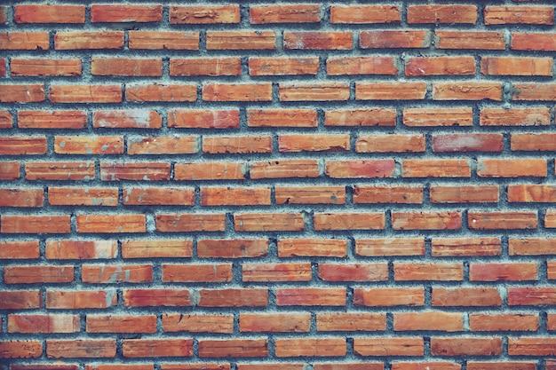 Abstracte achtergrondmuurtextuur oude roodbruine bakstenen muur