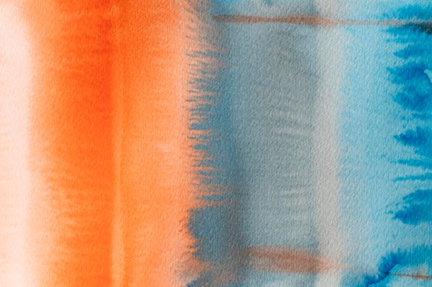 Abstracte aquarel oranje en blauwe achtergrond