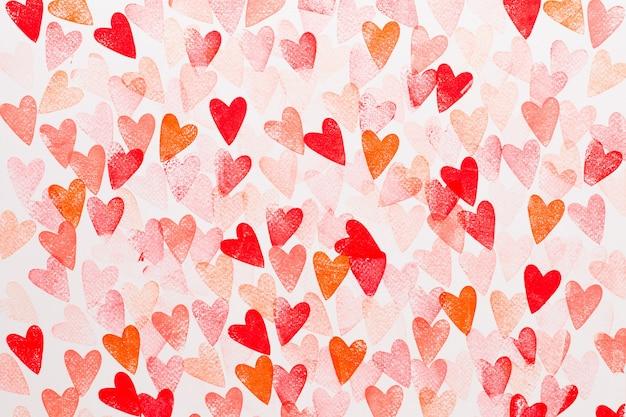Abstracte aquarel rood, roze hart achtergrond. concept liefde, valentijnsdag wenskaart.