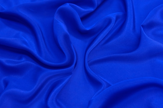 Abstracte blauwe kleur zijde chiffon stof textuur achtergrond.