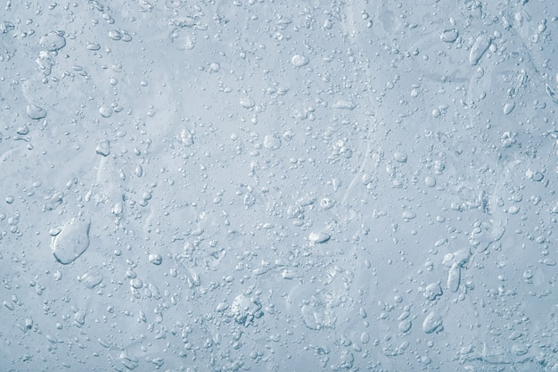 Abstracte blauwe vloeistof. textuur van dikke transparante gel met veel bubbels. cosmetica product.