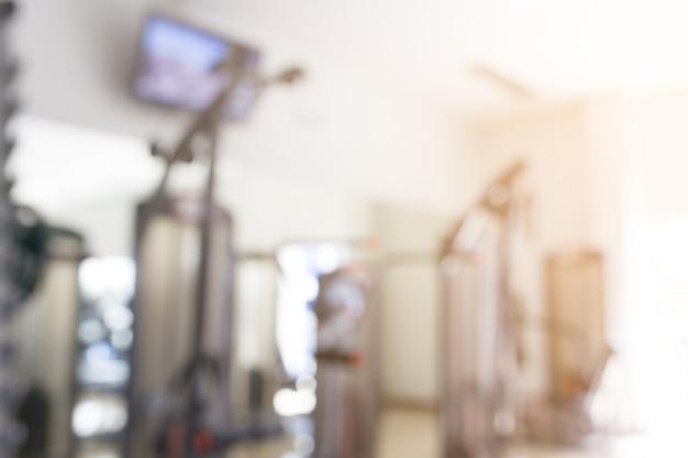 Abstracte blur fitness gym met apparatuur voor achtergrond.