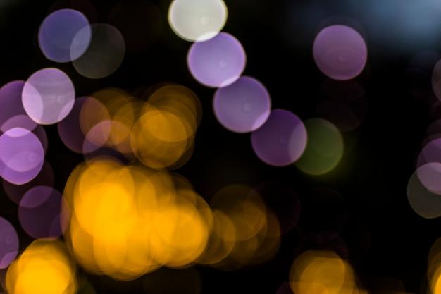 Abstracte bokehachtergrond bij nacht