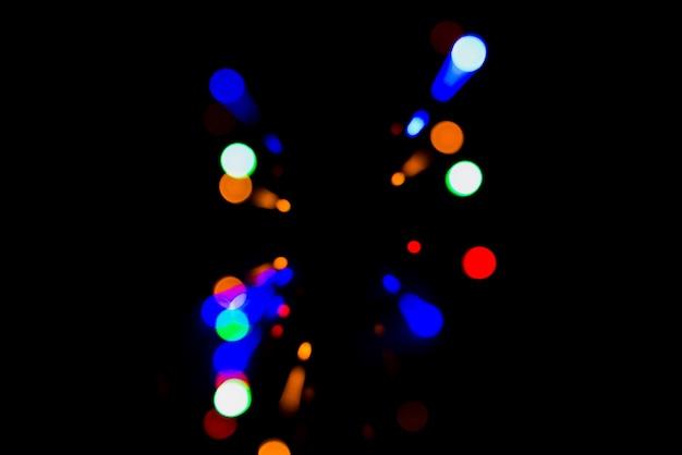 Abstracte bokehachtergrond met kleurrijke lichten