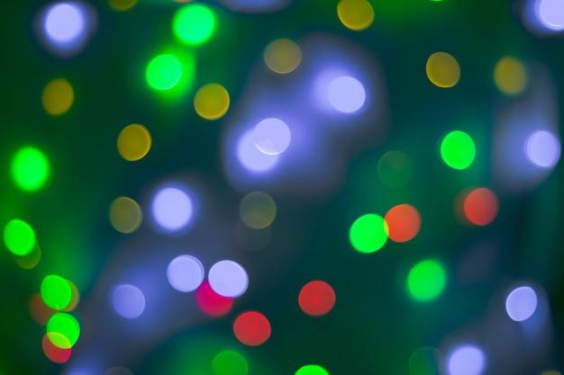 Abstracte cirkelbokehachtergrond van kerstmislicht