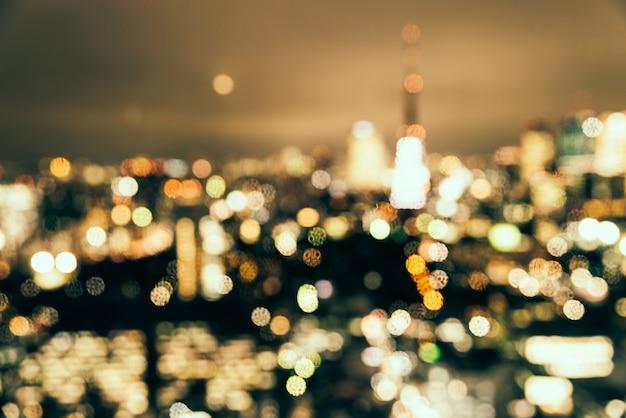 Abstracte de stadsachtergrond van onduidelijk beeld bokeh tokyo