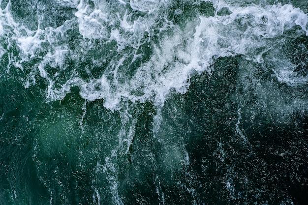 Abstracte de textuurachtergrond van water oceaangolven.