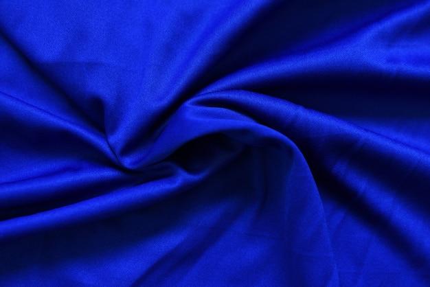 Abstracte donkerblauwe verfrommelde stoffentextuur